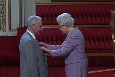 Dr Kingsland receives his honour from the Queen