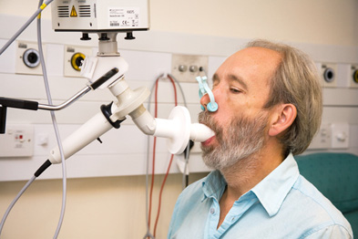 Patient breathing into a spirometer during a lung function test (Photograph: SPL)