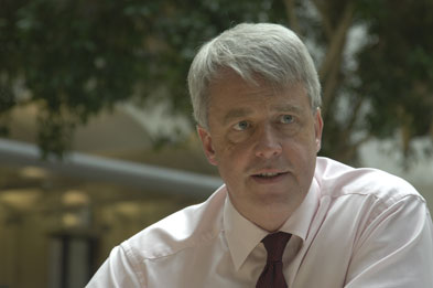 Andrew Lansley said NHS funds are being swallowed up by the number of management