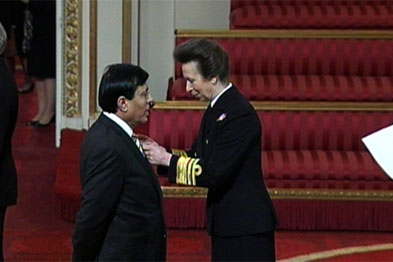 Dr Chand receiving his OBE