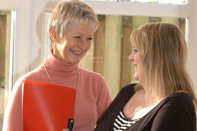 Lynda Hind (left) with one of her patients