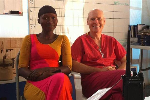 Dr Charles Heatley with Agnes, a community health officer at the Kerrytown Ebola Treatment Centre