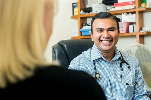 Dr Ravi Shetty in his GP surgery in Camarthenshire, South West Wales