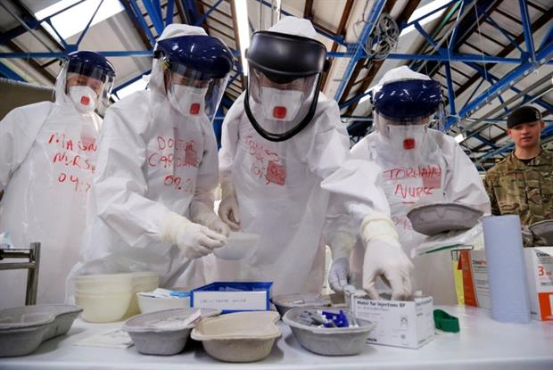 Ebola volunteers: medical staff train to work in a Sierra Leone treatment centre (Photo: DFID)