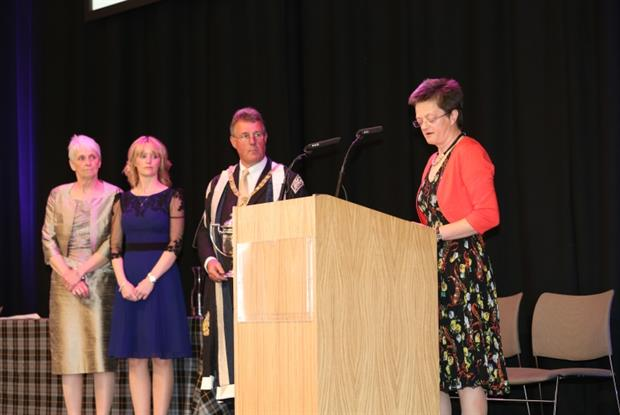 GP of the year Dr Sue Farrar accepts her award from RCGP president Professor Mike Pringle and patients (Photo: RCGP)