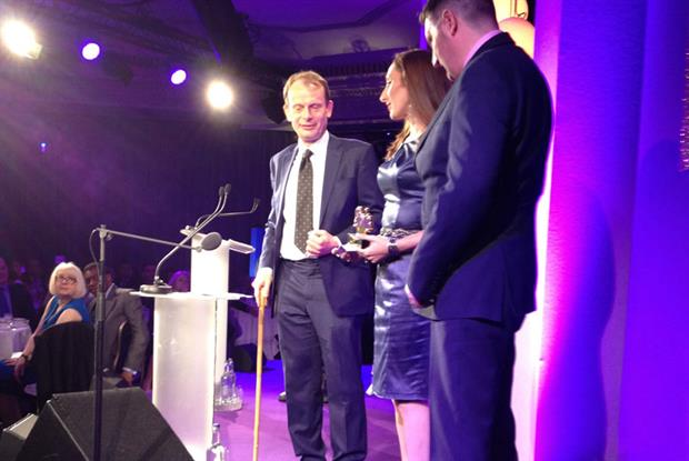 Andrew Marr presents the award to Melissa Peters as Andy Pearce looks on Pic: N Durham