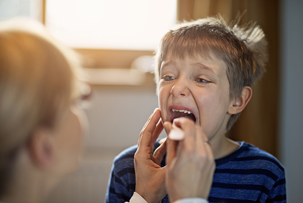 GPs should cut back on antibiotic prescriptions for sore throats