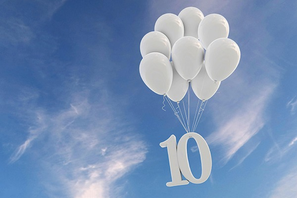 Balloons carrying number 10 sign