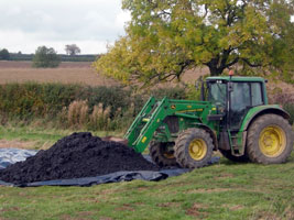 Compost-like output from Leicester City's MBT plant being spread on farmland. This will no longer count as recycling under government plans (credit: ADAS)