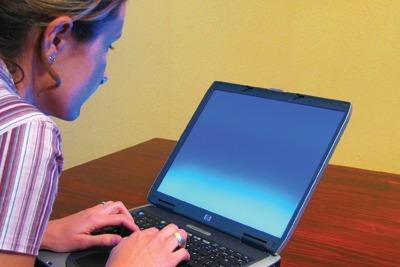Woman on laptop, courtesy of Matthew Bowden, Wikimedia