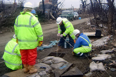 Environment Agency officers investigate the Buncefield disaster