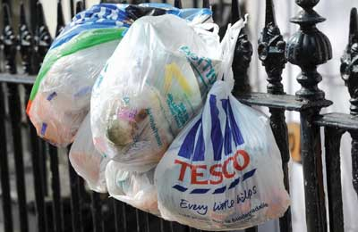 Plastic carrier bags being reused to for waste (Credit: Betty Finney/Alamy)