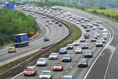 Motorway traffic. Credit:DBurke, Alamy