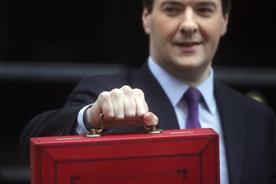 Chancellor George Osborne holding his red box. Cuts are holding back green progress survey finds