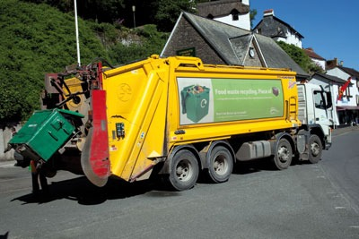 A council truck disposes of food waste collected from households in Lynmouth, Devon (photo: Mark Boulton/Alamy)