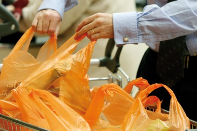 Single-use plastic bags being loaded into shopping trolly (picture: Sainsbury's)