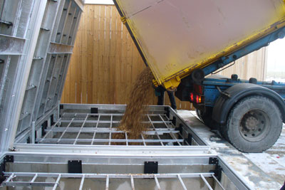 Woodchips being poured into a biomass storage tank. The EU believes DECC is offering large biomass projects too much support (Photo: Econery)