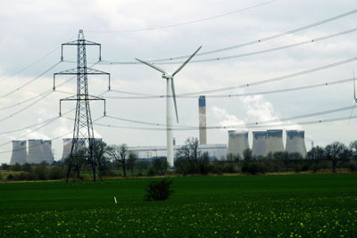 Wind turbine next to the Drax coal-fired power station (photo: David Rogers CC-BY-SA-2.0 via Geograph)
