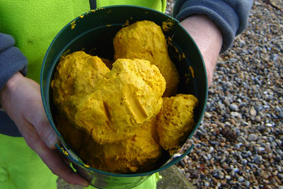 Yellow waxy material was washed ashore on beaches in East and West Wittering (photo: Environment Agency)