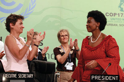 Christiana Figueres and Maite Nkoana-Mashabane celebrate COP 17 deal (picture: AFP/Getty)