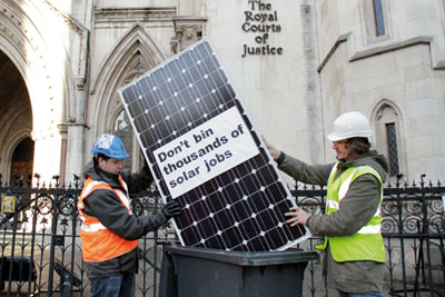 Protesters unhappy with cuts to solar feed-in tariffs outside the Royal Courts of Justice (picture: Friends of the Earth)