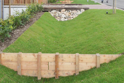 Examples of sustainable drainage systems include shallow ditches called swales (credit: Yellow Book CC BY 2.0)