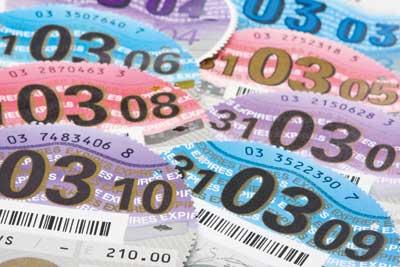Tax discs. Credit: Jonathon Ball/ Alamy