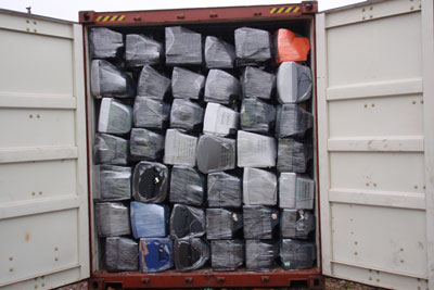 Containers were often 'dressed' with well-wrapped and labelled items in the front few rows to conceal the broken electronics behind (photograph: Environment Agency)