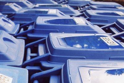 Blue recycling bins. Credit: Genista