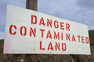Contaminated land sign (credit: Robert Brook/Alamy)