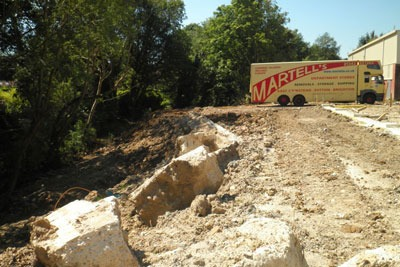 Martell's of Sutton dumped nearly seven times the permitted amount of waste on the railway cutting. Credit: EA