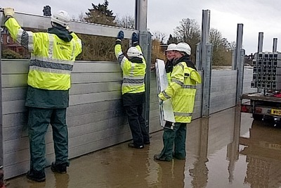 Environment Agency staff extending flood barriers along the river Severn, Bewdley (photograph: Dave Throup)