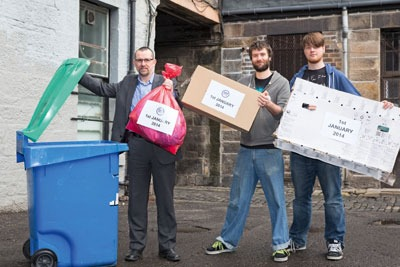 Recycling being placed into a bin. Credit: Zero Waste Scotland