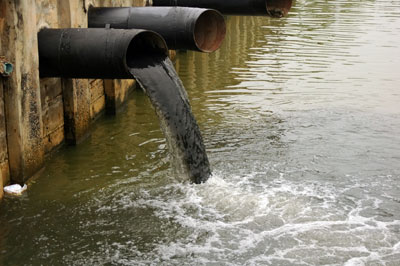 sewer pipe discharging into water