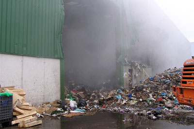 Some of the backlog of waste self-combusted causing a serious fire (photograph: Environment Agency)