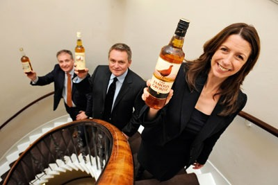 Lightweight whiskey bottle launched by Marissa Lippiatt, chief executive of Resource Efficient Scotland, with Glen Gribbon, director of The Famous Grouse (middle) and Scottish environment secretary Richard Lochead