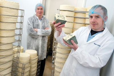 Huw Lloyd, Business Account Manager at WRAP (left) with Mark Jones of the Carmarthenshire Cheese Company (right) (photograph: Welsh government)