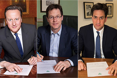 David Cameron, Nick Clegg and Ed Miliband have all signed the cross-party agreement (photograph: Green Alliance)