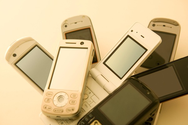 There are about 76 million phones left unused in people's homes. Photograph: PaylessImages/123RF