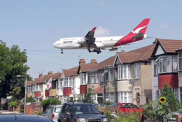 Aircraft using Heathrow Airport pass very close to housing. Photograph: Adrian Pingstone