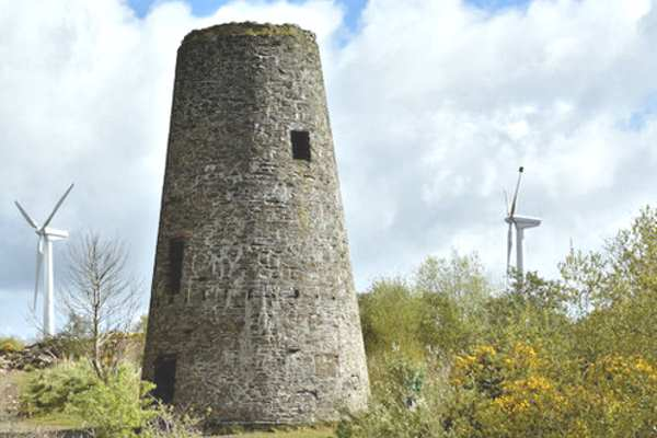 The site of this derelict industrial wind mill in Newtonards has been taken over by two wind turbines. Photograph: Albert Bridge (CC BY_SA 2.0)