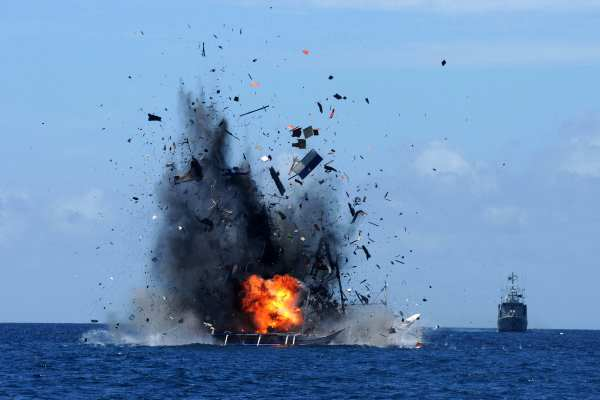 The Indonesian Navy blowing up a foreign vessel caught fishing illegally. Photograph: EPA/IMANK