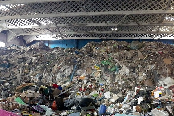 The waste, which included plastic, plasterboard, wood, carpet and rubble, posed a significant fire risk. Photograph: Natural Resources Wales