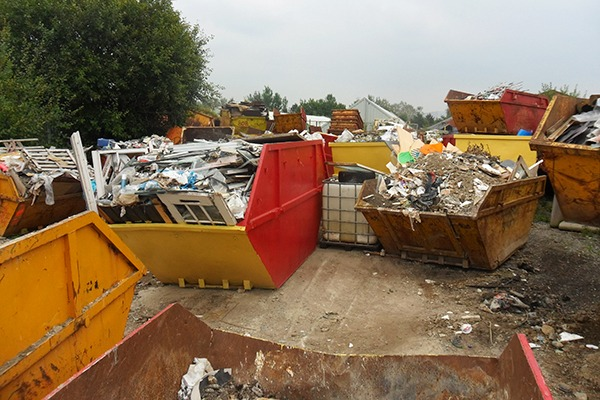 Mohammed Rashid stored more than four times the amount of waste allowed on his Keighley site, as well as overflowing skips by the road outside. Photograph: Environment Agency