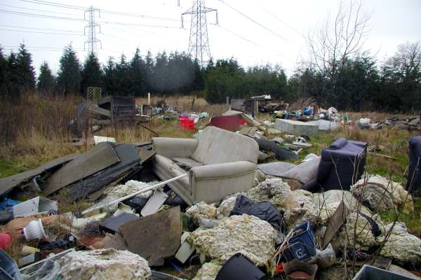 Fly-tipped waste on a field