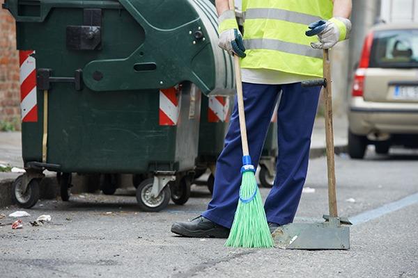 Clearing litter. Photograph: Dmitry Kalinovsky/123RF