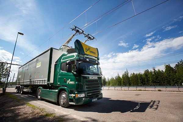 """Promising technology or """"slightly bonkers""""? Siemens and Scania's hybrid lorry uses power from electric cables strung over a 2km stretch of Swedish motorway. Photograph: Scania"""