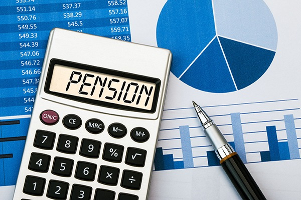 Calculator with pension on screen sitting on a graph