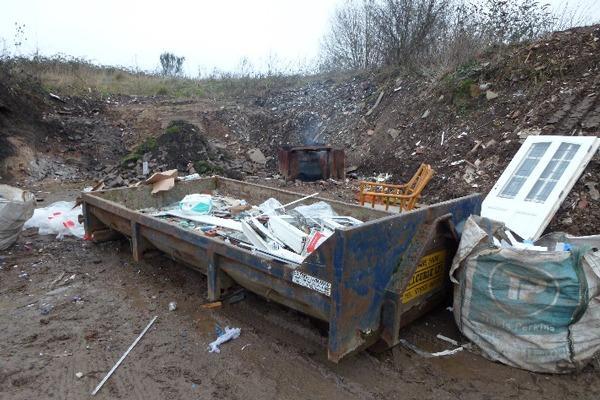 MJ Curle had been collecting, transporting and storing skips full of waste without an environmental permit. Photograph: Environment Agency.