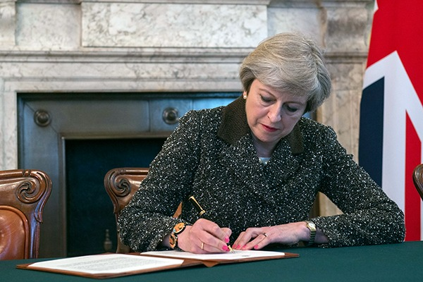 May has been urged not to weaken environmental protections. Photograph: No 10
